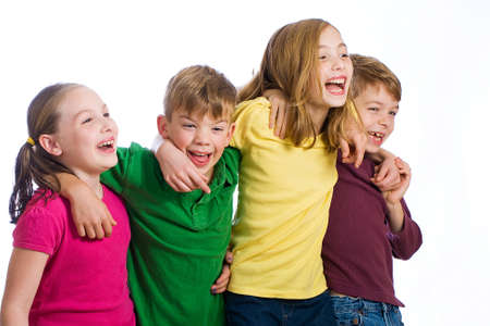 Group of four young kids in colorful shirts having fun Stock Photo