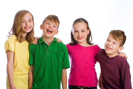 Group of four young kids in colorful shirts having fun 스톡 콘텐츠