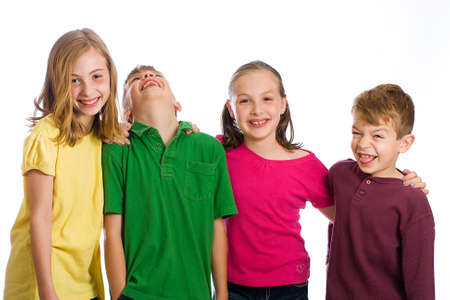 Group of four young kids in colorful shirts having fun photo