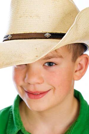 Knappe jonge kind in een cowboyhoed