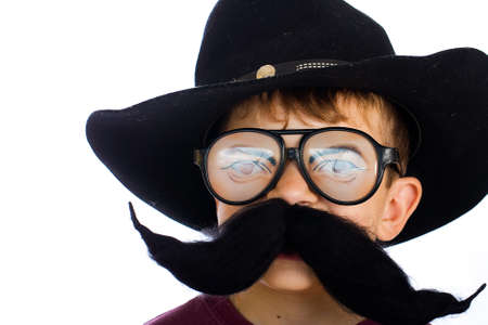 funny costume: Funny young boy in cowboy hat with weird glasses Stock Photo