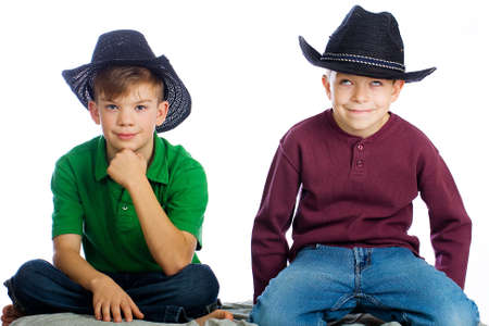 Two handsome young boys with cowboy hats photo