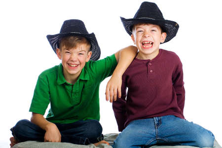 Two handsome young boys with cowboy hats Stock Photo - 11245217