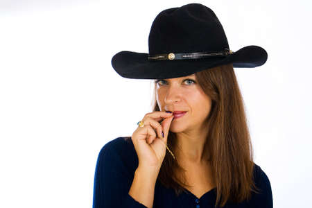 country girl: Beautiful country girl wearing a cowboy hat Stock Photo