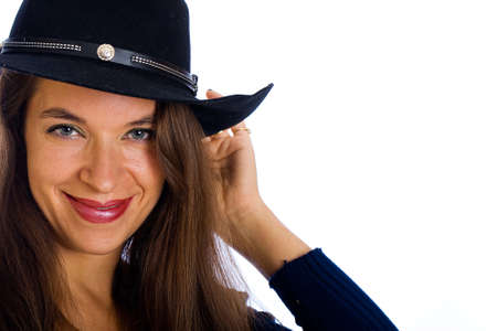 Beautiful country girl wearing a cowboy hat photo