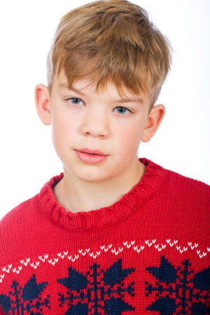 bummed: handsome young boy in a red sweater Stock Photo