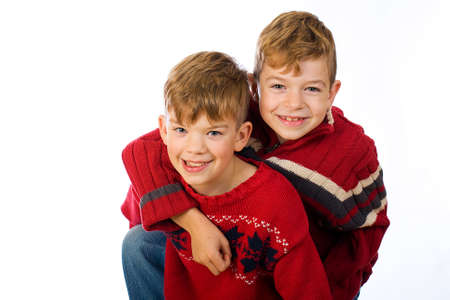 two cute young boys wearing red sweaters photo