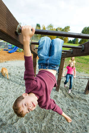 upside down: Young boy playing at a park