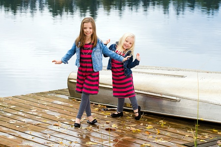 Two cute kids playing at a lake photo