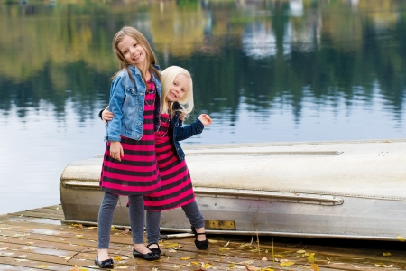 Two cute kids playing at a lake Stock Photo - 12029143