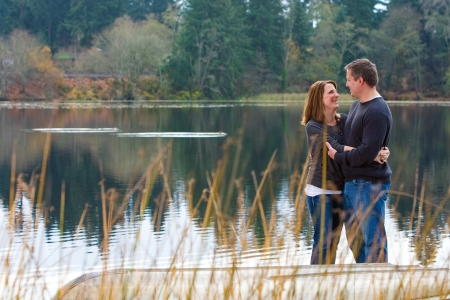 romantic couple in love at a quiet lake photo