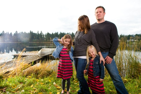 Happy Family outside near a lake Stock Photo - 12036921