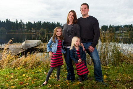 Happy Family outside near a lake photo