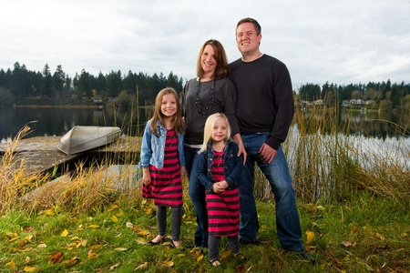 Happy Family outside near a lake photo