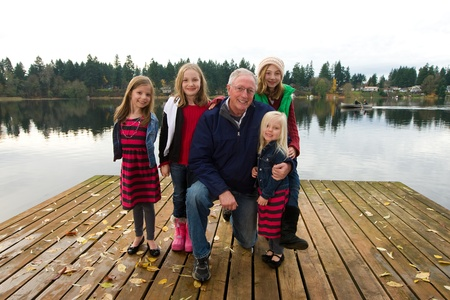 Happy Grandpa with a group of kids photo