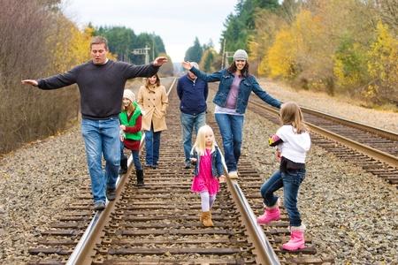 group of people walking on train tracks