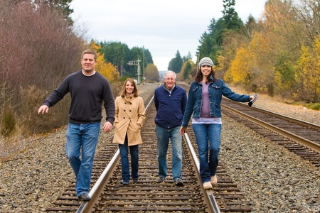 group of people walking on train tracks photo