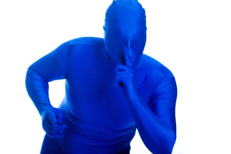 anonymous, faceless man in a blue mask shushing for quiet
