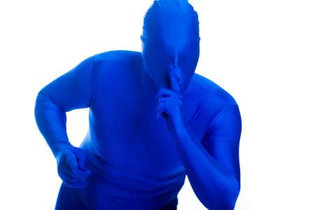 shushing: anonymous, faceless man in a blue mask shushing for quiet