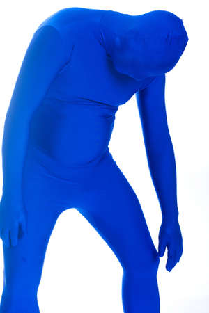 bummed: anonymous, faceless man in a blue mask sad, depressed and hunched over Stock Photo