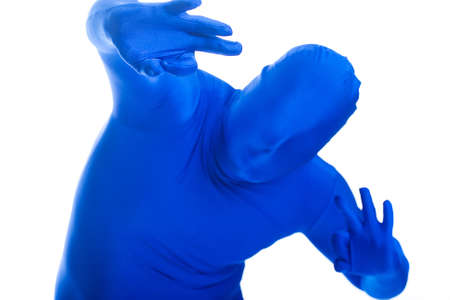 featureless: Faceless, anonymous man in a blue body suit with OK sign.
