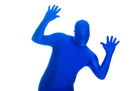 featureless: Faceless, anonymous man in a blue body suit raising the roof. Stock Photo