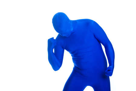 featureless: Faceless, anonymous man in a blue body suit celebrating a victory.