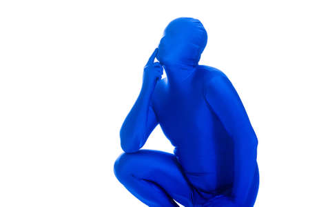 Faceless man in a blue body suit thinking about something. Stock Photo - 11808523