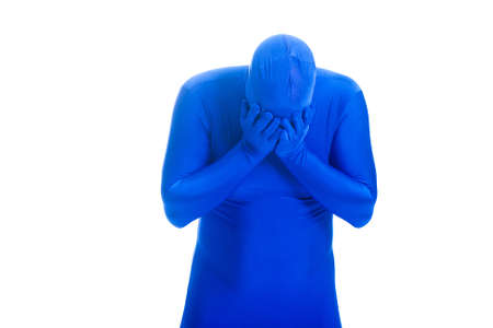 sobbing: Anonymous, faceless Blue Man sobbing Stock Photo