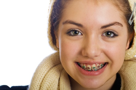 orthodontist: young teenager with braces and a happy smile
