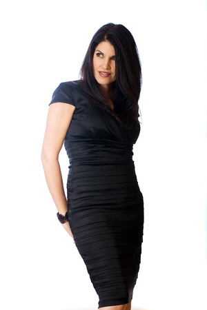Sexy, middle aged woman in a black cocktail dress Stockfoto