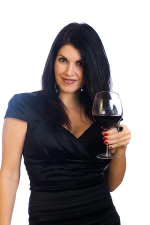 Mooie vrouw van middelbare leeftijd drinken van een glas rode wijn