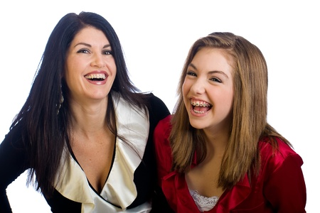 cute braces: Middle aged Mom and teenager daughter laughing Stock Photo