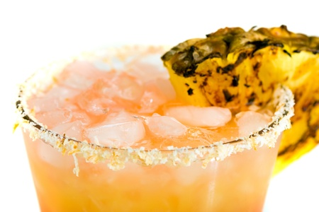 mocktail: floating icecubes and a toasted coconut rim on a fruit cocktail
