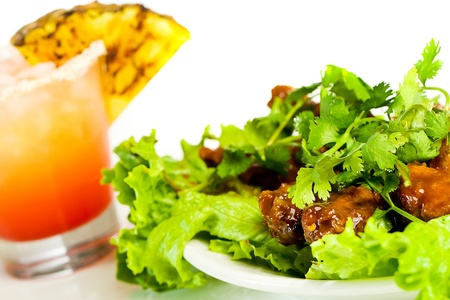 mocktail: Chicken wings and a tropical cocktail Stock Photo
