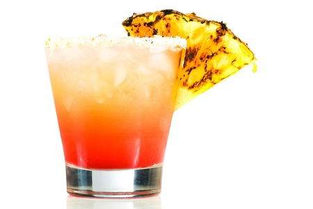 pineapple  glass: Tropical fruit drink with a pineapple garnish