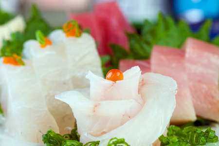 Raw Fish shaped like a flower at a Fine Dining Sushi Restaurant photo