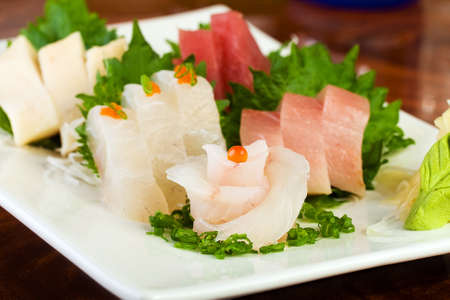 Fresh, raw fish at a gourmet sushi restaurant photo