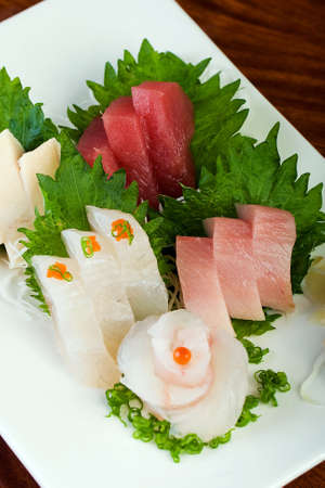 Raw Fish on a platter at a Sushi restaurant. photo