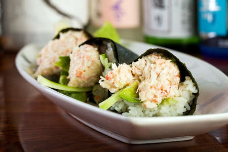 cone shaped: Fresh Snow Crab stuffed in cone shaped hand rolled sushi. Stock Photo