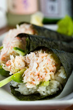 Fresh Snow Crab stuffed in cone shaped hand rolled sushi. Stock Photo