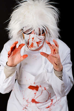 Scary Doctor covered in blood after a gory surgery.