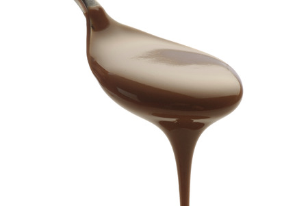 parfum: cuillire flowing chocolate on white background Stock Photo