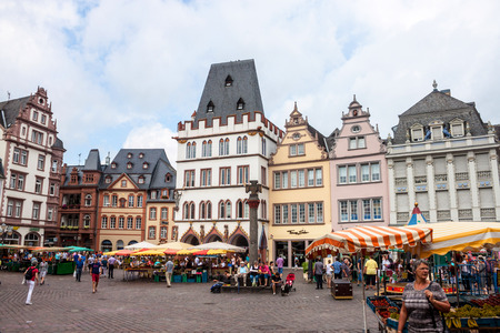 hauptmarkt: TRIER, GERMANY- AUGUST 3: People and stalls at Market square in Trier, Germany, on August 3, 2013. Trier is the oldest city in Germany, founded in 16 BC.