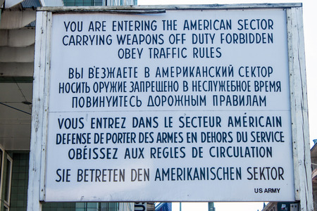 Sign at Checkpoint Charlie that divided east and west Berlin, Germany
