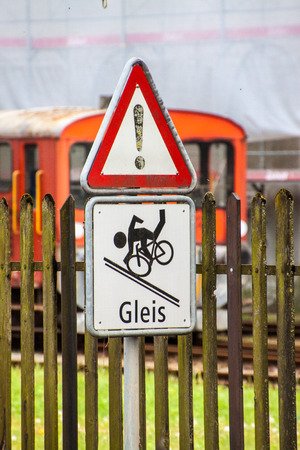 Warning traffic sign for cyclists at railway crossing, Switzerland photo