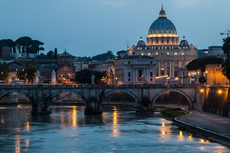 in copula: Angel bridge and St. Peters Basilica copula in Rome, Italy during sunset