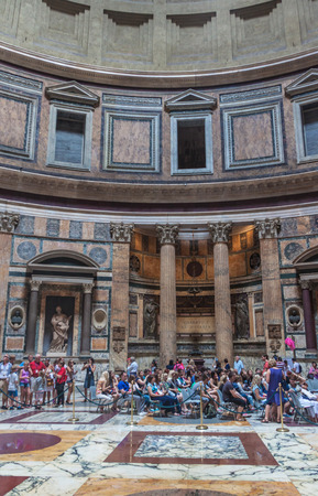 2nd century: ROME - JUNE 25: Tourists visit the Pantheon on June 25, 2014 in Rome, Italy. Pantheon is a famous monument of ancient Roman culture, the temple of all the gods, built in the 2nd century.