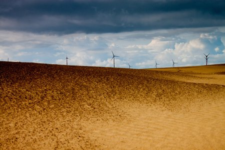 Wind power plants at Thar desert in Rajasthan, India photo