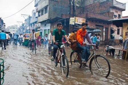 rains: VARANASI, INDIA - AUGUST 11: Flooded street on August 11, 2011 in Varanasi, Uttar Pradesh, India. Indias monsoon rains were 14 percent above normal in the week to Aug. 10, 2011.